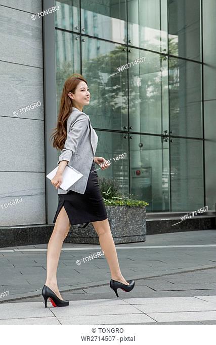 Smiling businesswoman walking