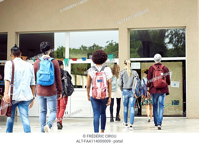 College students walking on campus, rear view