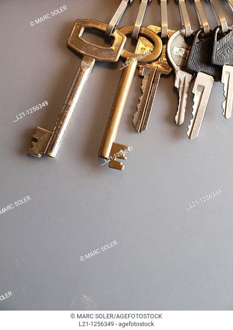 Keys on a keychain, grey background