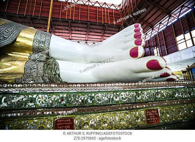 Close-up of the legs and feet of the reclining Buddha statue displaying the pink toenails. Chauk Htat Gyi Pagoda, Yangon, Myanmar