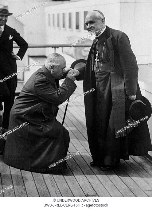 New York, New York: June 11, 1926.Spanish Ambassador Del Riano on bended knee kissing the hand of Cardinal Reig y Casanova, Archbishop of Toledo