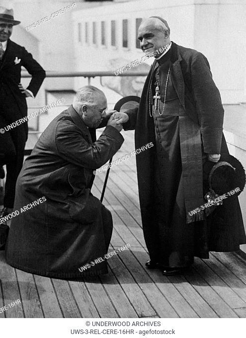 New York, New York: June 11, 1926.Spanish Ambassador Del Riano on bended knee kissing the hand of Cardinal Reig y Casanova, Archbishop of Toledo