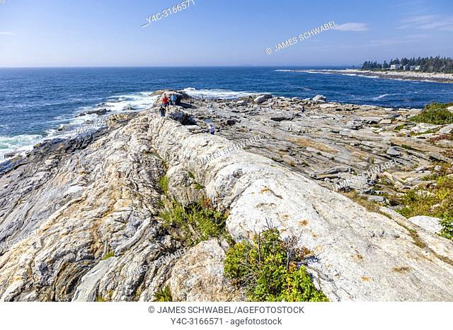 Rocky Atlantic coast in front of Pemaquid Point Lighthouse in Bristol Maine