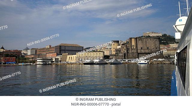Boats at dock by city, Naples, Campania, Italy