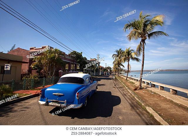 Old American car at Punta Gorda district, Cienfuegos, Cuba, West Indies, Central America