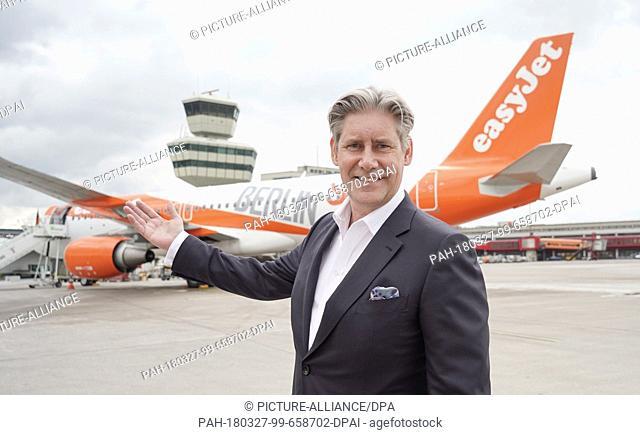 "27 March 2018, Germany, Berlin: Easyjet CEO Johan Lundgren standing in front of an Easyjet Airbus A320-214 in """"Berlin colours"""" in Berlin's Tegel Airport on..."