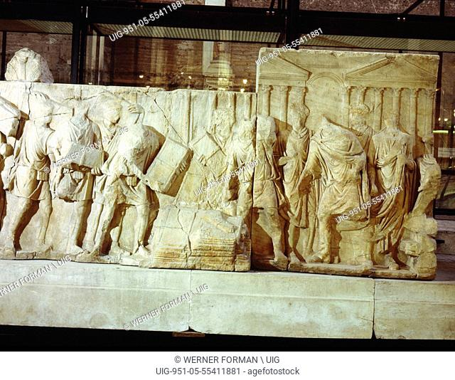 Part of a marble relief apparently showing various measures taken by Trajan