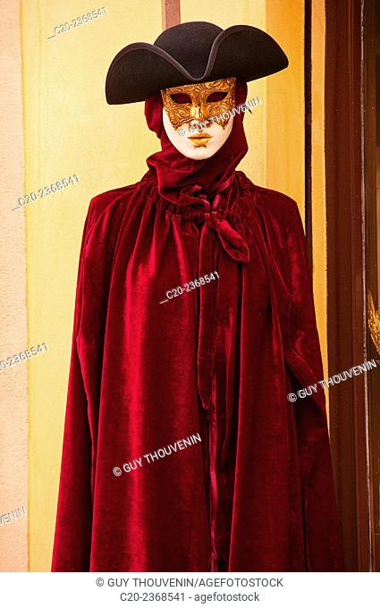 Carnival mask, typical three cornered hat and tabarro, typical cloak, Venice, Italy