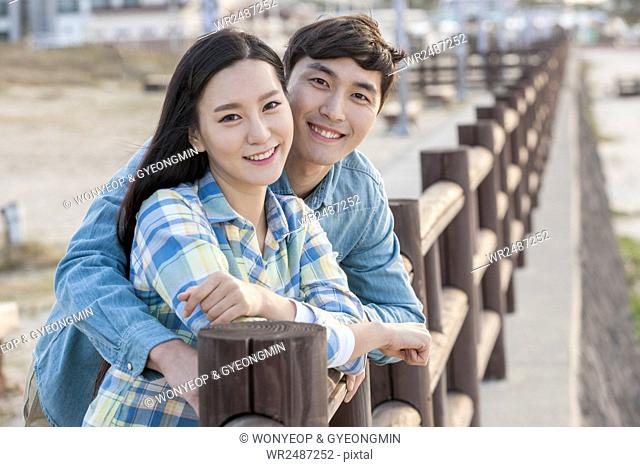 Portrait of young smiling couple at beach