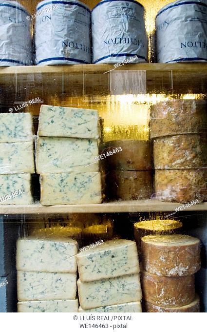 Pile of Stichelton and Stilton cheese on a cheese store, Neals Yard, Borought Market, Southwark, London, England, UK, Europe
