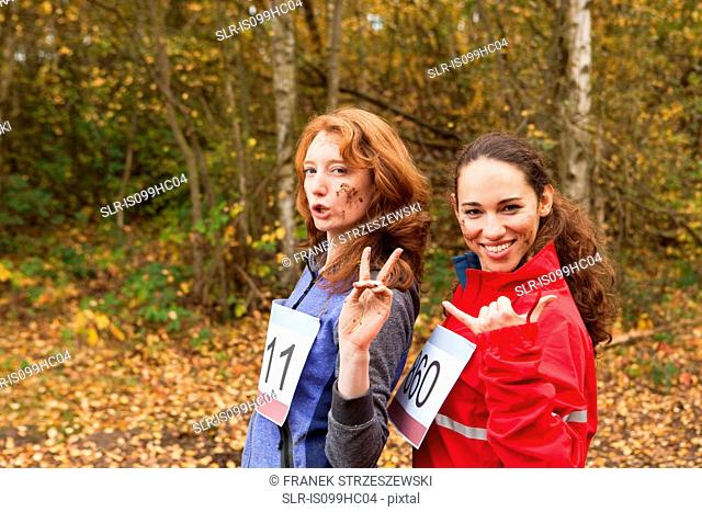 Young women smiling in forest, portrait