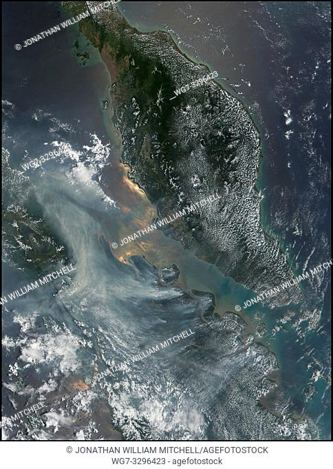 EARTH Indonesia -- 13 Mar 2002 -- The smoke was so thick over some parts of Sumatra, Indonesia, in late February 2002 that officials were forced to close...