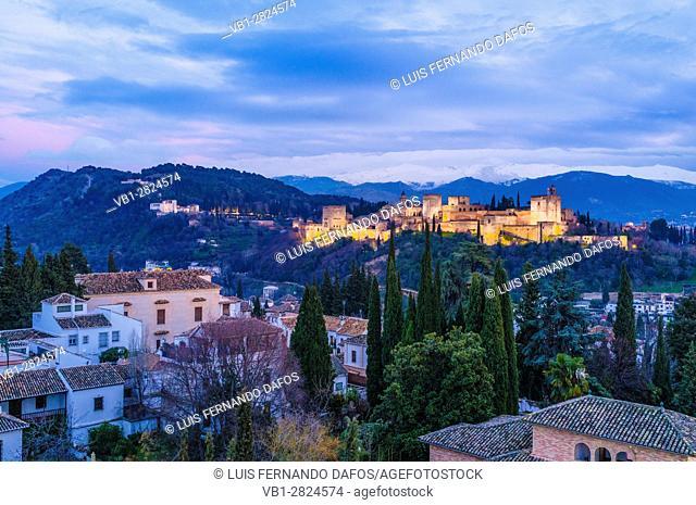 Illuminated Alhambra palace and Unesco listed Albaicin quarter at dusk. Granada, Andalusia, Spain
