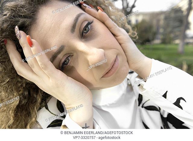 emotive woman in park, in Paris, France