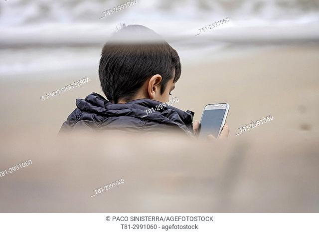 child with his mobile phone, Tarragona