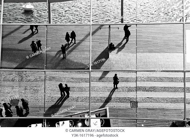 Reflection in the glass facade of the Maremagnum mall, Port Vell, Barcelona, Catalonia, Spain