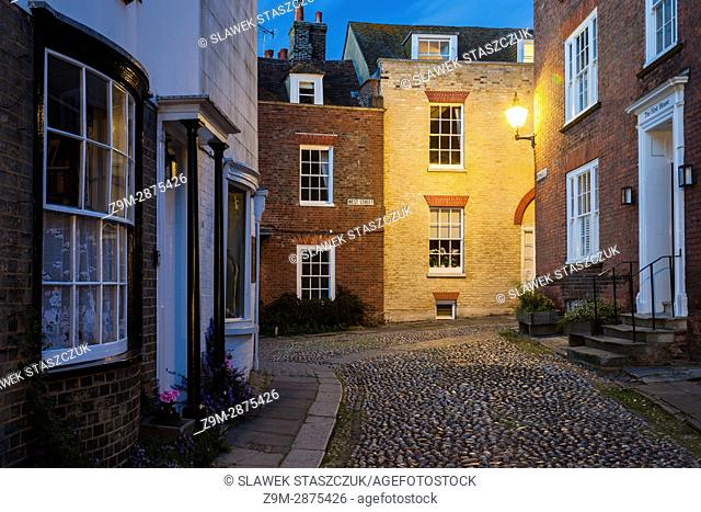 Night falls on the iconic Mermaid Street in Rye, East Sussex, England
