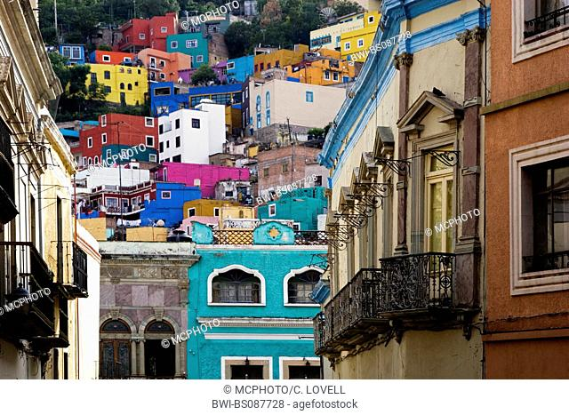 Fine quality wrought iron balconies and brightly colorful houses define the architectural style of the historical town of Guanajuato, Mexico, Guanajuato