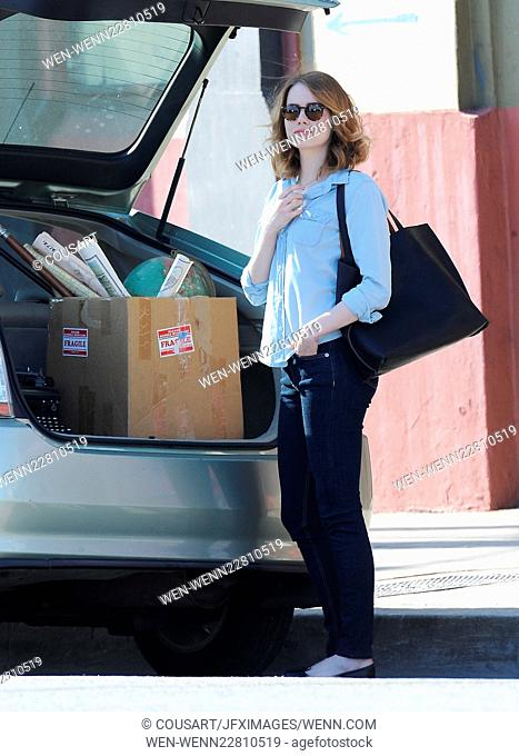 Emma Stone has her hands full with a box of music and office supplies on the set of 'La La Land,' currently filming in Los Angeles Featuring: Emma Stone Where:...