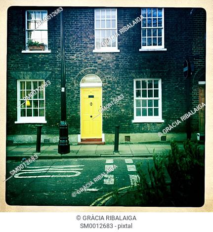 Facade of a typical English house with yellow door, Southwark, London, England, UK, Europe