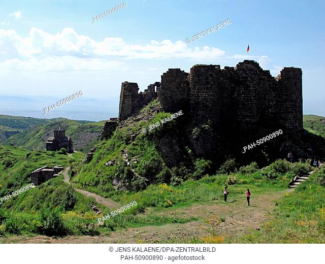 A view of Amberd castle (R) and the church of Surp Astvatsatsin (Holy Mother of God) (L) near Byurakan, Armenia, 28 June 2014