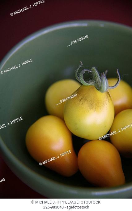 Yellow cherry tomatoes in bowl