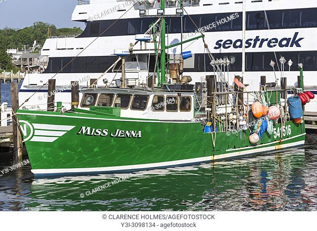 "Commercial fishing boat """"Miss Jenna"""" docked next to a Seastreak ferry in Vineyard Haven Harbor, in Tisbury, Massachusetts on Martha's Vineyard"