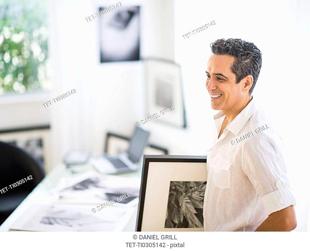 Portrait of man in his photography studio
