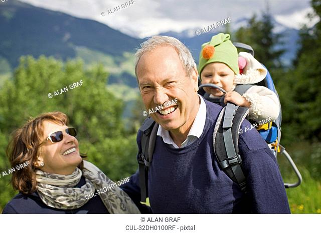 Older couple walking with grandchild