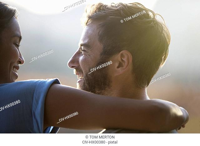 Close up smiling couple hugging