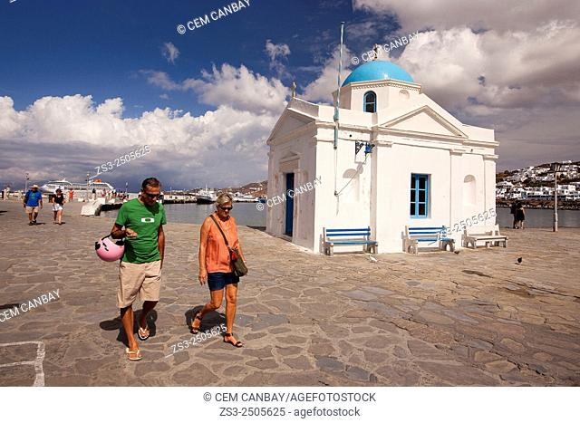 People near a blue domed church at town center, Mykonos, Cyclades Islands, Greek Islands, Greece, Europe
