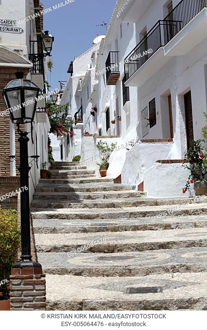 Small street in Andalusian mountain village Frigiliana, Spain
