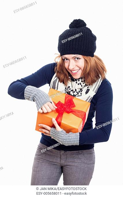 Happy winter woman opening present, isolated on white background