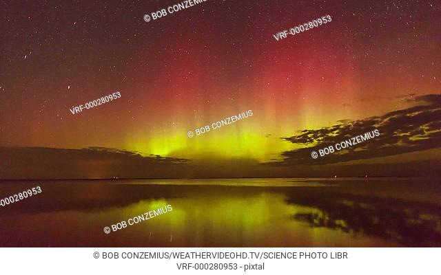 Timelapse footage of the Aurora Borealis, or northern lights, over a lake. Auroral displays are caused by interactions between energetic charged particles from...
