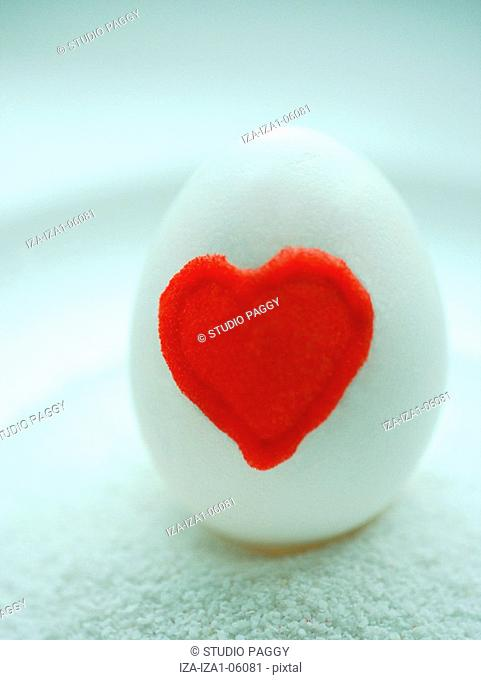 Close-up of a heart painted on an egg