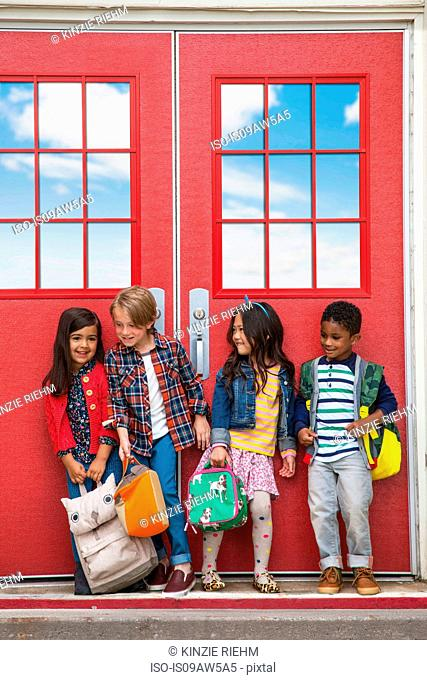 Children outside elementary school on first day of school