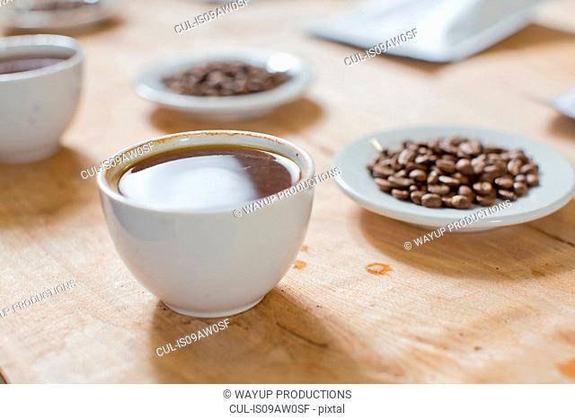Cups of coffee, saucers of coffee beans