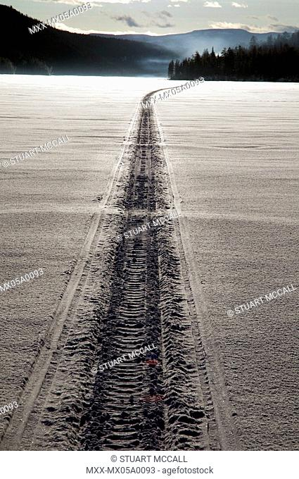 Snowmobile tracks on the frozen Stock Photos and Images