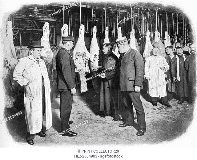 Inspecting meat at Smithfield Market, City of London, c1903 (1903). Artist: Unknown