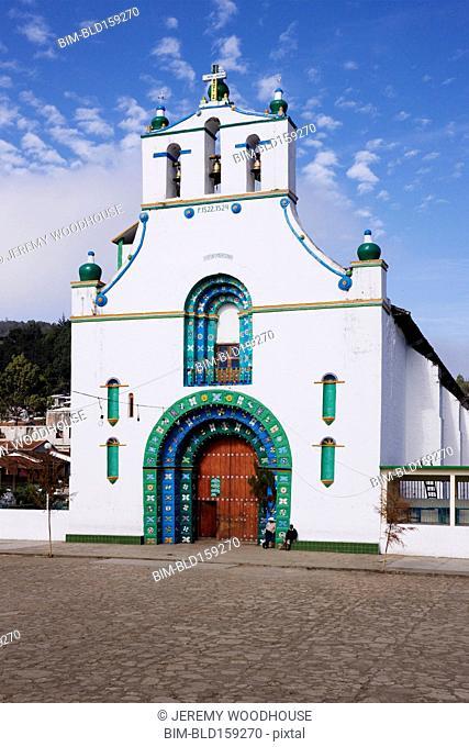 Church facade under blue sky, San Juan Chamula, Chiapas, Mexico