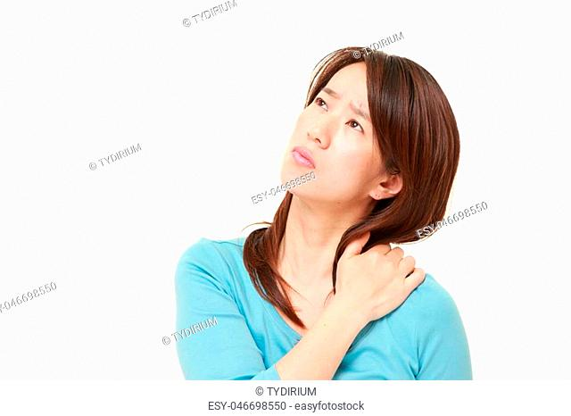 portrait of middle aged Japanese woman suffers from neck ache