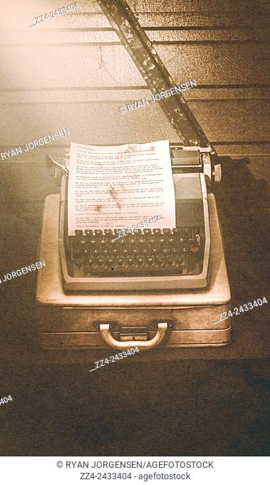 Vintage 1940s war concept of a British typewriter turned enigma machine deciphering complex code with theoretical mathematics to intercept strategies and plans...