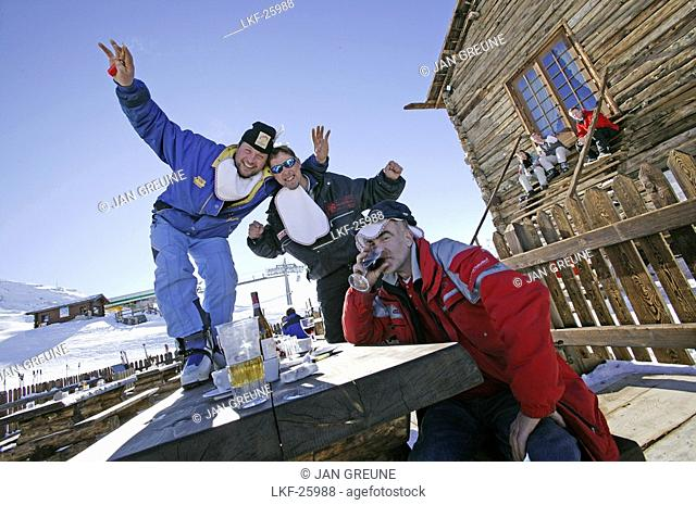 Guests having fun at the ski hut Camanel die Planon, Livigno, Italy