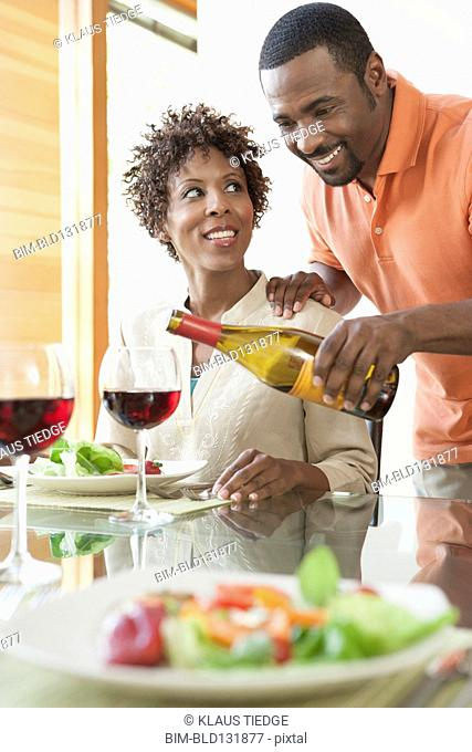 African American couple having wine at dinner