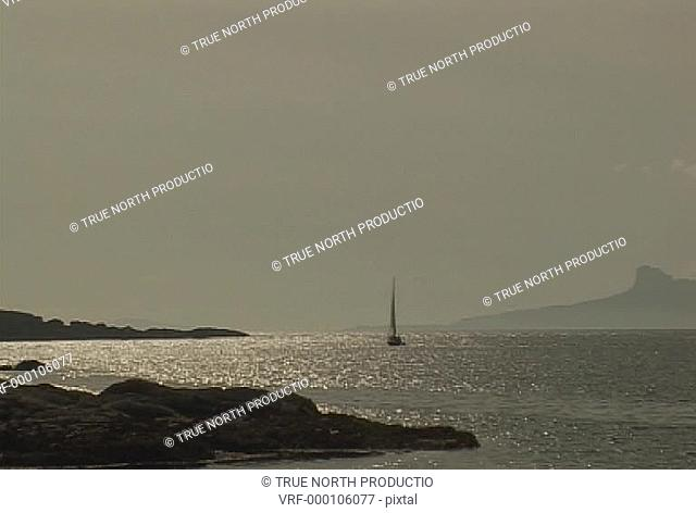 GV, West Coast Scotland, UK , W3S, clear blue sky and water, rocky foreground, boat in distance, peaceful, tranquill