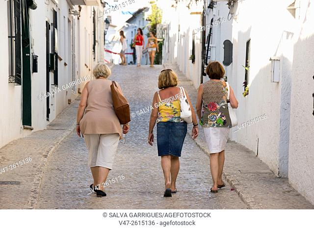Three women walking through the streets of Altea, Altea, Alicante, Valencia, Spain, Europe