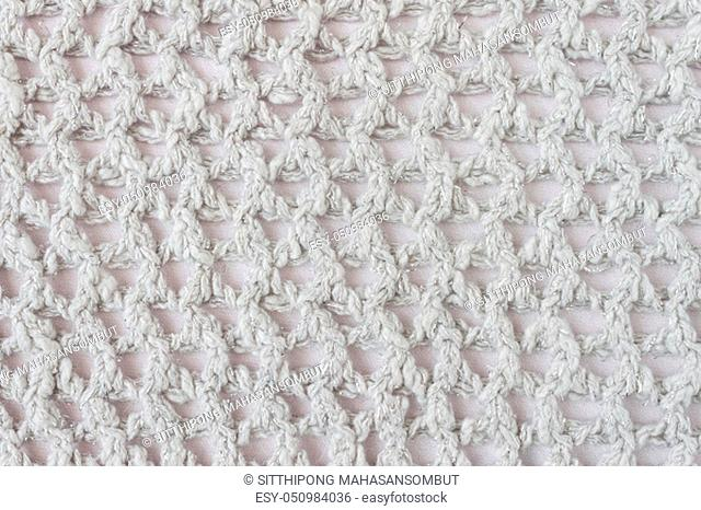 White Knitting Pattern or Knitted Pattern Background in macro style. Knitting Pattern or Knitted Pattern in vintage style for design
