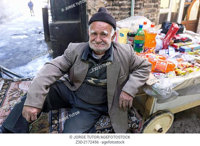 Old man seller in in Bazar-e Bozorg, Iranian seller in Isfahan, Iran