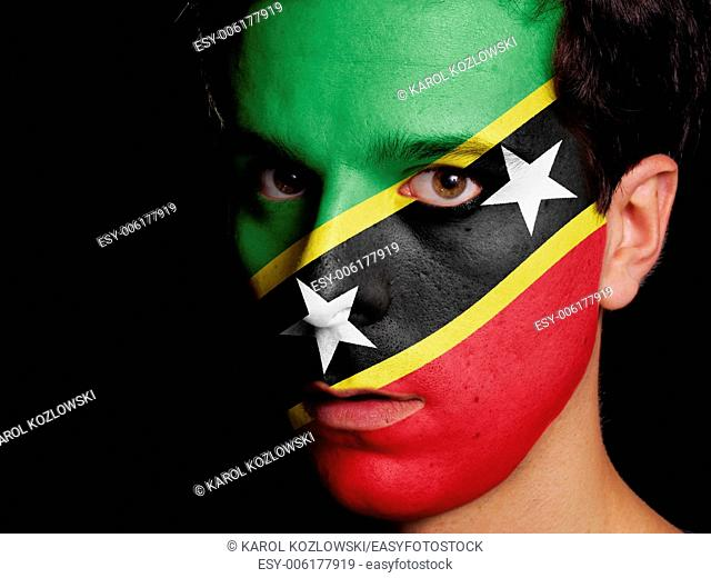 Flag of Saint Kitts and Nevis Painted on a Face of a Young Man