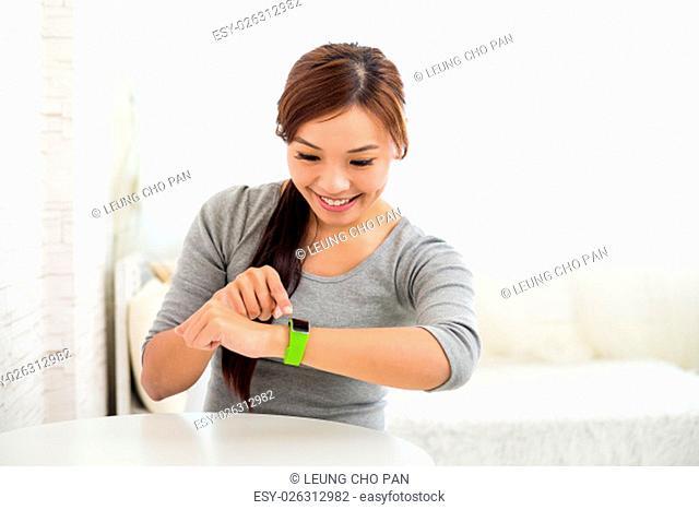 Woman use of wearable watch